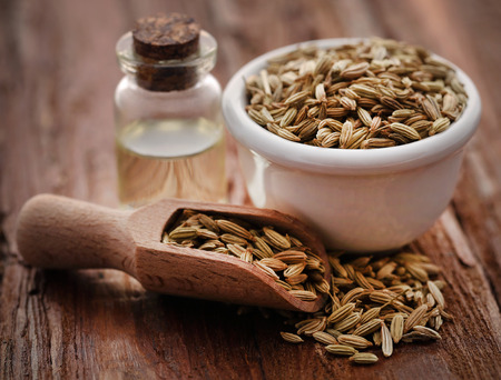 Fennel seeds with essential oil in a bottle Stok Fotoğraf