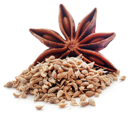 Anise seeds   and star anise over white background