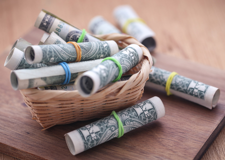 Rolled US Dollars symbolized as food product