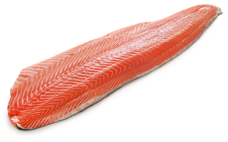 Large piece of uncooked salmon fish over white background