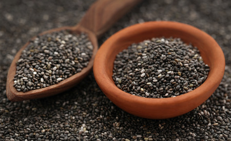 Organic Chia Seed, super food in wooden spoon and small pottery Stock Photo