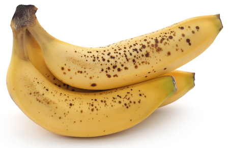 Spotted banana over white background 스톡 콘텐츠