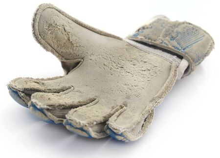 Old football gloves over white background