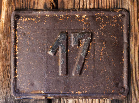 17: Old rusty house number 17 Stock Photo