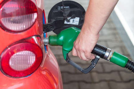 natural gas prices: Car filled with fuel at gas station Stock Photo