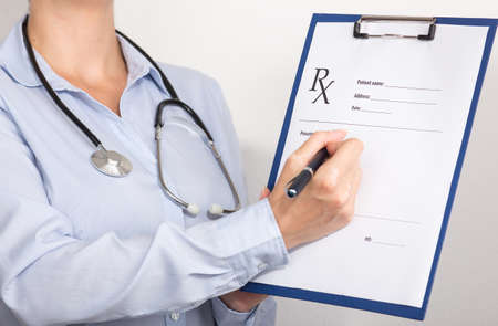 doctor writing: doctor writing prescription paper Stock Photo