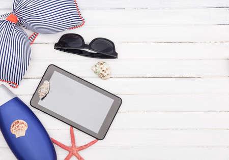 sun screen: Bikini sun screen  sunglasses and tablet sea star Stock Photo