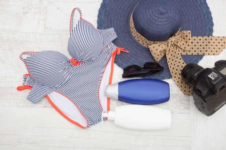 sun screen: Blue bikini sun screen  sunglasses and camera Beach accessories