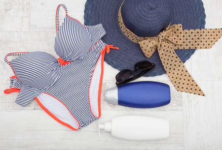 sun screen: Blue bikini sun screen and sunglasses Beach accessories Stock Photo