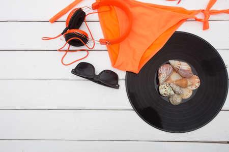 earphone: Bikini sunglasses and  earphone
