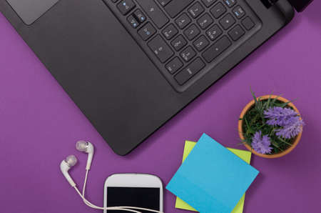 keyboard: desk with headphones, pc, phone and plant Stock Photo