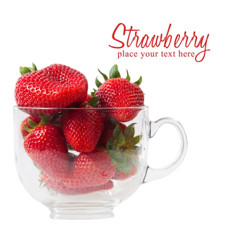 Strawberries in a glass isolated on white background