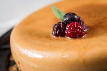 CREME CARAMEL WITH BERRIES