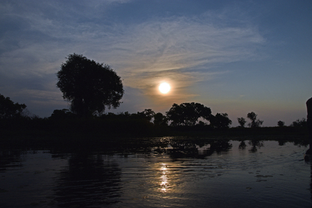 Sunset on Okavango Delta Stock Photo
