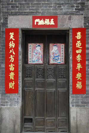 posting: There is a custom of posting couplets written on red paper on doors Editorial