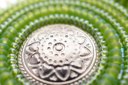 shiny buttons: Seed bead embroidered green mandala with metal button. Hand made art object