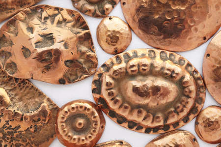 Hand made ethnic copper copper medallions Stock Photo