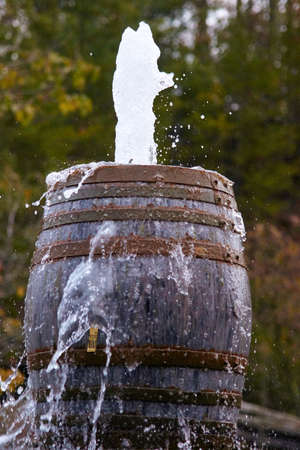 Rustic Old barrels shooting water out of the top.