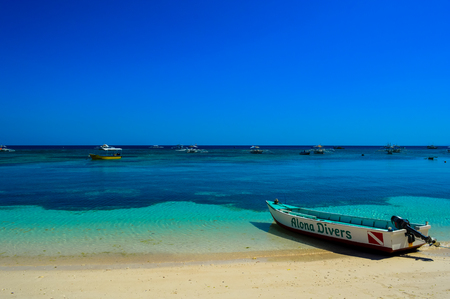 White sandy beach and crystal clear waters of Panglao Beach, Bohol, Philippines