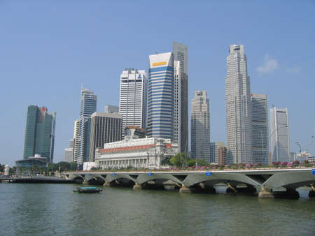 towerblock: Singapore City Skyline across the River, Southeast Asia Stock Photo