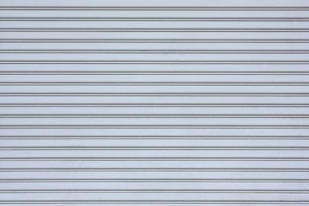 Gray Sliding steel door with horizontal lines  Stock Photo - 9494836