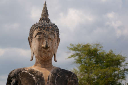 Close up of the beautiful stone Buddha statue of the Wat Maechon, in Sukhothai's Historical Park, Thailand Фото со стока