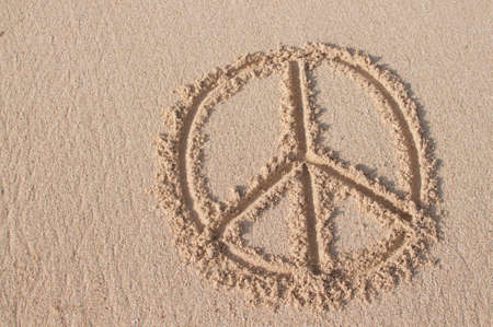 Peace symbol drawn at Melasti beach in Bali, Indonesia