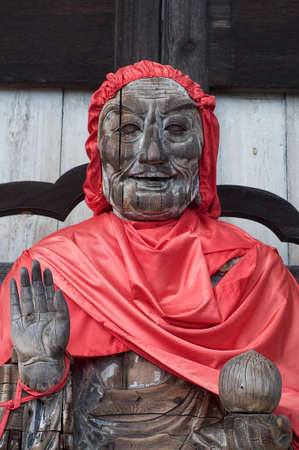 NARA, JAPAN - SEPTEMBER 27, 2018 : Portrait of the wooden statue of Binzuru (Pindola) at the entrance of the Great Buddha Hall (Daibutsuden) at the Todai-ji Temple