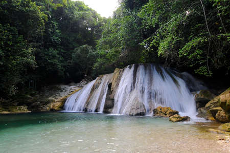 Manchioneal, Portland, Jamaica - 13th June 2017 : View on the beautiful Rech Falls near Manchioneal Village in Jamaica. This waterfalls are one of the most visited touristic attraction in Portland Zdjęcie Seryjne