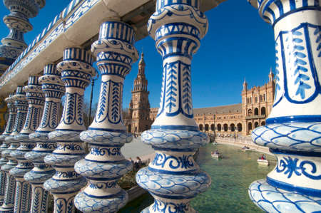 Seville, Andalucia, Spain - 4th January 2015 : Picture of the north tower of the Plaza de España between the beautifully ceramic decorated handrail located in the city of Seville, Spain