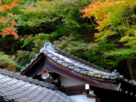 Detail picture of a typical Japanese style rooftop architecture captured during autumn at the Eikand temple in Kyoto, Japan