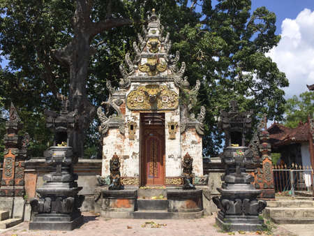 Typical beautiful Balinese entrance gate of a temple in Nusa Lembongan in Bali, Indonesia