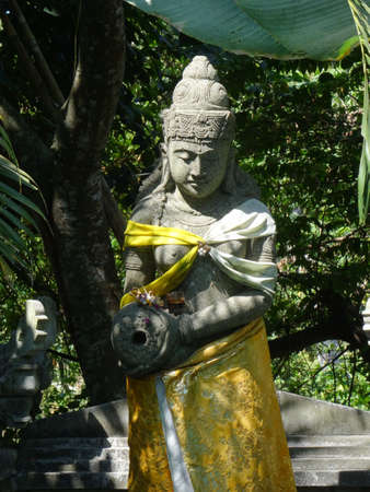 Beautiful view of a typical balinese stone statue captured in a garden in Ubud, Bali - Indonesia