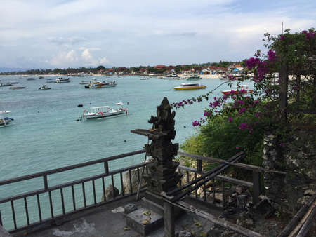 View over a typical Balinese shrine, Jungtu Batu Bay and his many boats in the water of Nusa Lembongan inBali, Indonesia