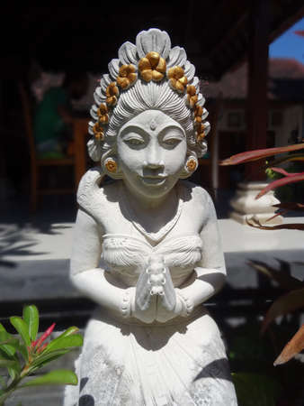 Beautiful white stone statue of a Balinese woman, captured in Sanur on Bali, Indonesia