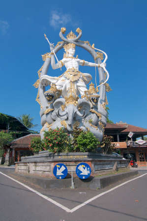 Ubud, Bali, Indonesia - 5th May 2019 : Low angle view on the majestic Arjuna Statue located at the roundabout in Ubud, Bali - Indonesia