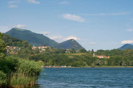 Beautiful lakeside view on the village of Agnuzzo, Mount Monte Boglia and Mount Monte Bre in the Lugano region in the Canton of Ticino, Switzerland