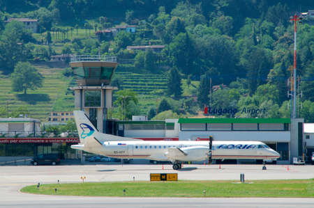 Agno, Ticino, Switzerland - 30th June 2019 : View on the Lugano-Agno airport with a parked air Adria Airplane located in the Canton of Ticino, Switzerland Editorial