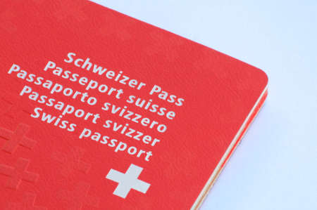 Close up view of one Swiss passport on a white background