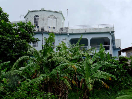 Fairy Hill, Portland, Jamaica - 16th June 2017 : Beautiful Jamaican house surrounded by lush nature, captured in the Portland area in Jamaica