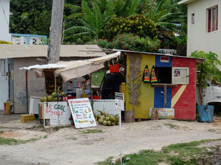 View of a Typical Jamaican little store that sell fresh coconuts and some snacks near the main road that leads to Ochos Rios from Fallmouth in Jamaica Editorial