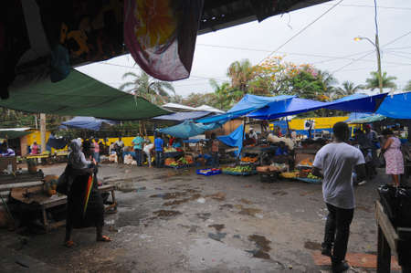 Port Antonio, Portland, Jamaica - 16th June 2017 : View on a rainy day, of the traditional farmer market in the city of Port Antonio in the Portland Parish, Jamaica
