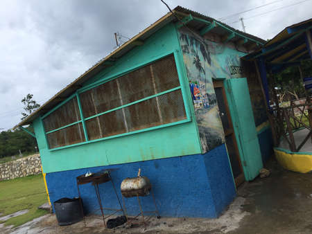 Port Antonio, Portland, Jamaica - 18th June 2017 : View of the back of a typical Jamaican restaurant with a rusty grill where usually the famous Jerk chicken is cooked. Located near Port Antonio