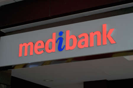 Brisbane, Queensland, Australia - 26th January 2020 : View of the Medibank logo hanging in front of the shop entrance in Brisbane. Medibank is an Australian private health insurance provider Redactioneel