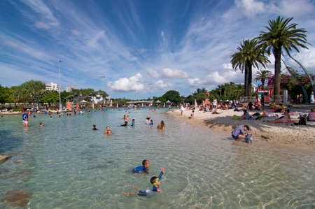 Brisbane, Queensland, Australia - 27th January 2020 : View of South Bank artificial street beach and pools on a sunny day with many tourists enjoying a bath in fresh water