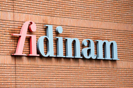 Lugano, Ticino, Switzerlad - 9th June 2020 : Close up of Fidinam logo hanging in front of the headquarters in Lugano. Fidinam is a multinational private consultancy company