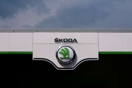 Lugano, Ticino, Switzerlad - 3rd June 2020 : View of the Czech Å koda car dealership logo hanging in front of the garage building in Lugano. is a Czech automobile manufacturer founded in 1895