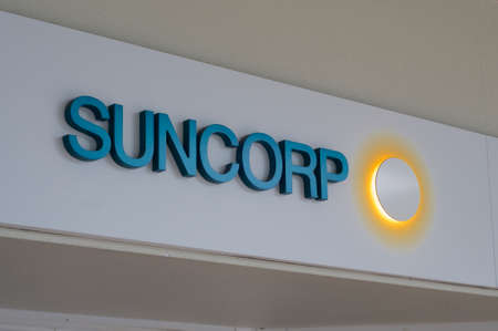 Ballina, New South Wales, Australia - 12th February 2020 : Suncorp Bank logo hanging in front of the headquarter in Brisbane. Suncorp is an Australian finance, insurance, and banking corporation