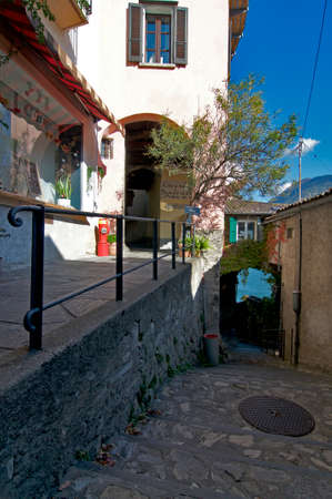 Lugano, Ticino, Switzerland - 17th October 2020 : Beautiful scenic laneway in Gandria. is a famous touristic village near Lugano in Switzerland 版權商用圖片