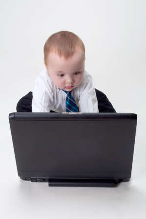 cute baby businessman working on his laptop
